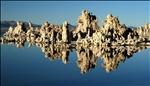 Tufa formation reflected on Mono Lake, California