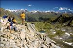 Hikers sitting on Munt Baselgia (2682 m) at the Swiss National Park, Zernez