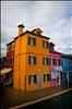 orange corner house in Burano