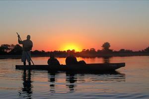 explore the delta in a mokoro