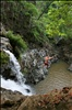 Jumping a tropical waterfall