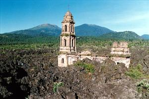 the bell tower emerging from the lava rocks